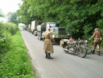 WW2 military vehicles on The Street