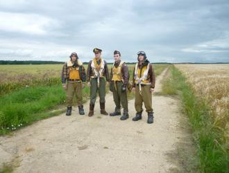 USAAF personnel in authentic WW2 uniforms on the airfield